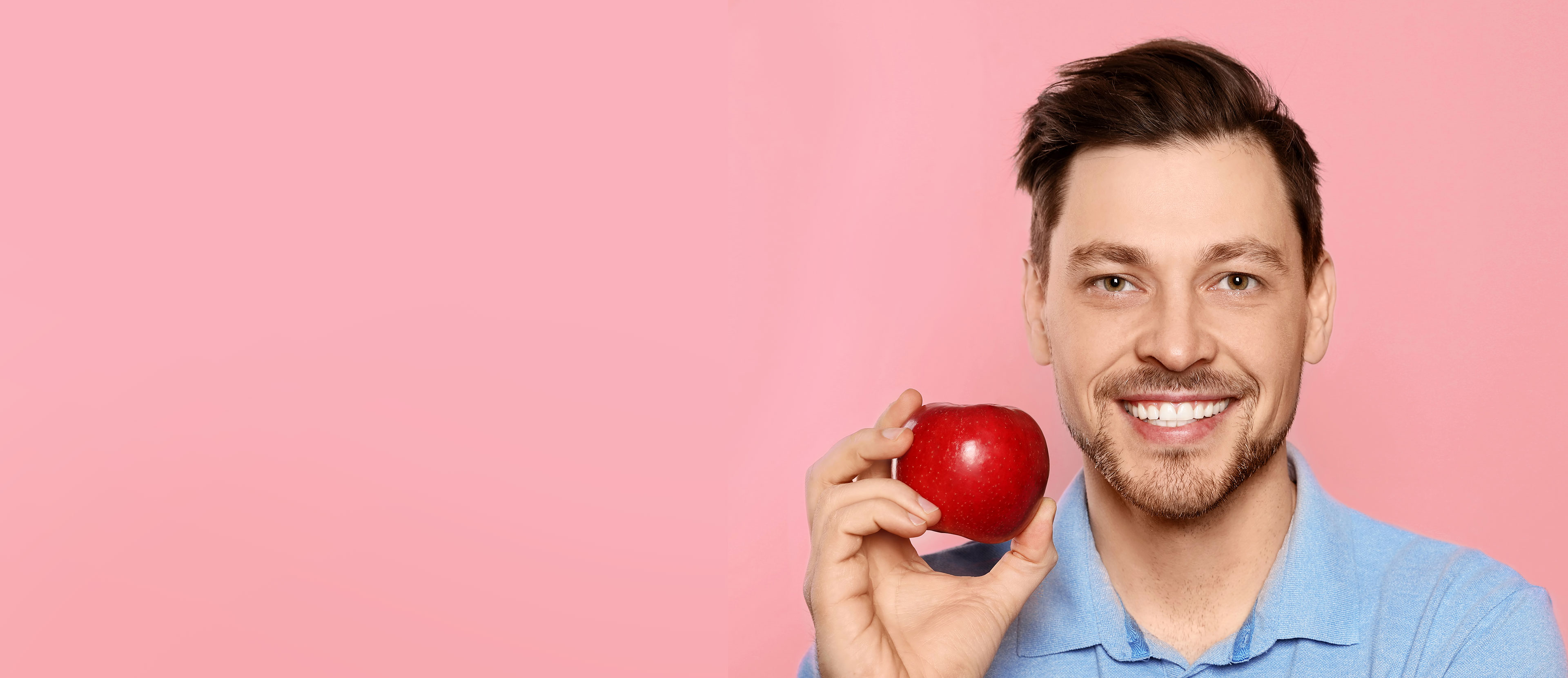Man with smiling holding apple